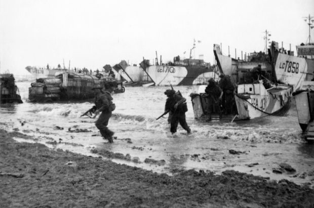 Commandos are seen here wading ashore from landing craft, onto the beaches of Normandy, June 1944 © Crown Copyright